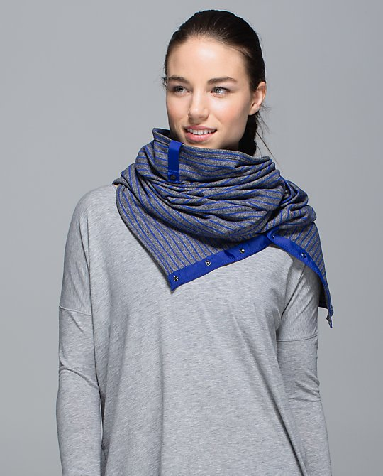 Vinyasa Scarf: Cozy, customizable circle scarf. It snaps so it could be a little bit of everything: a scarf, a wrap, a shrug, a hood – you name it! Designed with soft, sweat-wicking and stretchy fabric, it's perfect for warming up, cooling down and extra-long walks home. Lululemon.com $48.00